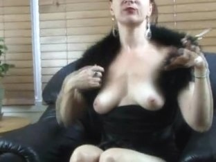 Brunette babe showing her big boobs and shaved pussy while smoking