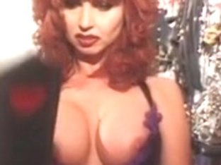 Lascivious stud spanked by a large boobs redhead