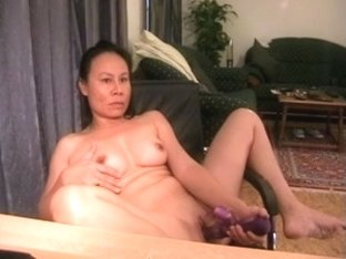 Mature Asian in a masturbation video