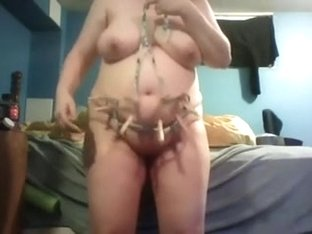 My busty and sexually excited older wife in mask playing in daybed