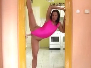 Horny gymnast plays with her hard dildo.