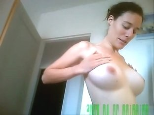 Busty girlfriend puts skin care lotion on her tits