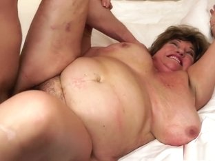 Big fat granny chews on his rod and gets her flab rolling as she fucks