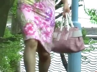 Japanese milf skirt sharked while walking down the stairs