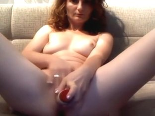 girl masturbates with a vibrator on the sofa and tastes her pussyjuice