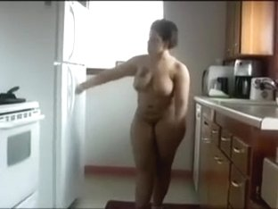 The captivating shape of my brown skin wife in the kitchen