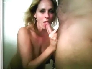 Big boobed blonde girl gives her man a blowjob, titjob and sucks his balls