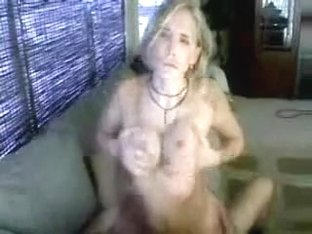 Hot blond rides cock on couch