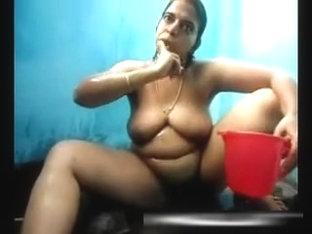 Mature aunty taking shower