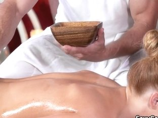 Oiled redhead fucked on massage table