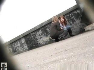 Two women caught pee in public