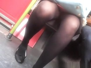 Woman in black stockings and skirt upskirted