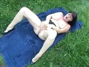 My wife fucks a dildo in the garden