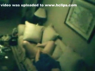 Voyeur tapes a brunette girl playing with herself on the sofa