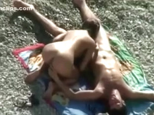 Cute and slender girl on the nudist beach is in the mood for oral sex