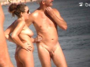 Stunning mature babes are sunbathing naked on the beach