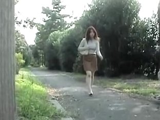Ass stretching scene of some curvaceous cutie being caught in the public park
