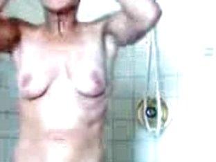 Attractive blonde MILF filmed taking a hot shower