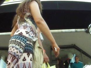 Hot chick in white dress filmed on hidden camera
