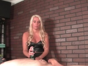 Mistress masseuse punishing sub with handjob