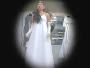 Asian bride spied in lingerie trying on the luxurious dressed