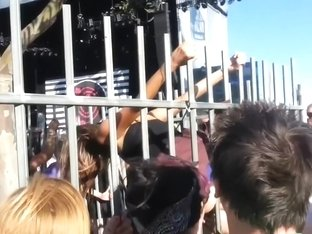 Blonde in the cage is performing erotic strip show in public
