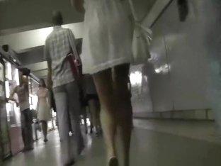 Blonde woman in short white dress upskirt