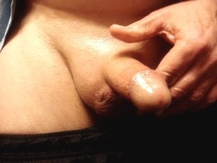 stroking my cock with oil and cumming