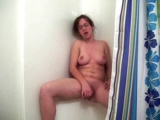 Geeky girl with a dildo in shower