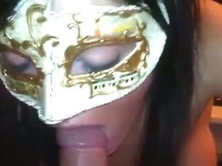Masked beauty giving head