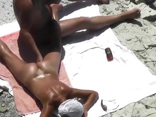 Fingering wifes cunt on a beach