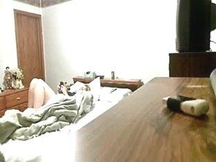 My mum masturbates on bed. Hidden cam