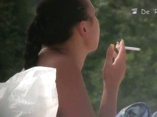 Hot nude bitch smoking cigs on the beach voyeur video