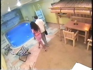 Couple pairing off in pool