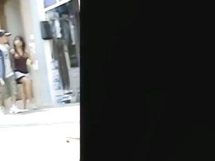 Public upskirt shot of a woman wearing pink panties