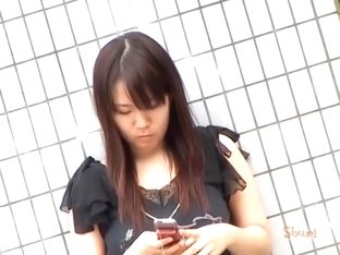 Tantalizing oriental chick messing with her phone during quick sharking scene