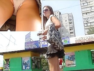 Well-clothed babe upskirt movie scene