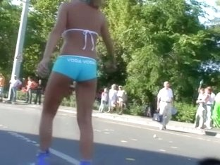 Street candid teen blonde girl in turquoise short pants