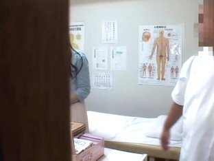 Cute Japanese gets heavily fingered in voyeur massage video