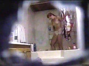 Hidden cam - girl taking a shower