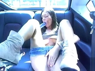 Hottie in the car fills her pussy with a toy