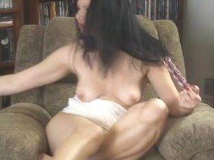 Hot MILF Mina sits on her chair and masturbates using a vibrator