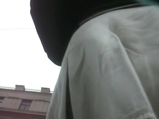 Young up white skirt view caught in the street
