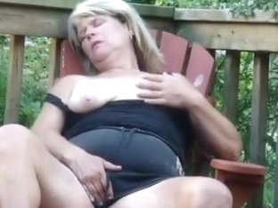 Granny masturbates on her porch