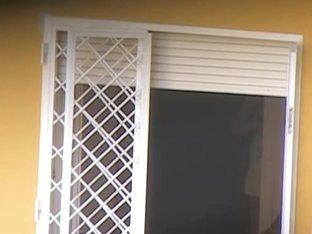 Nasty neighbor films somebody through the window