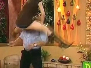 Dark-haired girl dancing with her partner on TV show