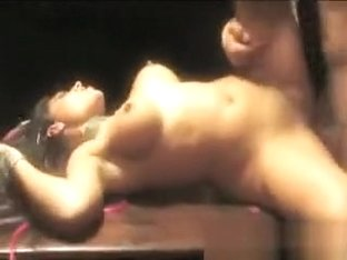 Stunning brunette gets chained to a table and roughly fucked