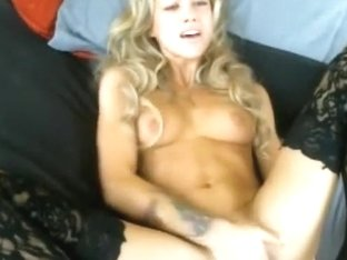Very cute blonde with curly hair masturbates in her black pantyhose