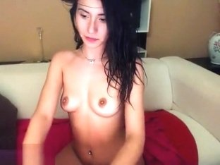 Naked brunette BellaLissa smokes and plays with vibrator