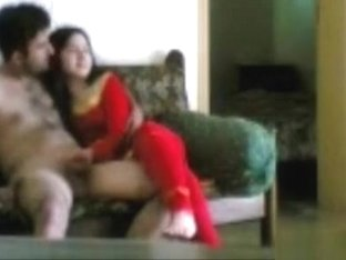 Arab girl gives her man a handjob and rides his cock on the sofa
